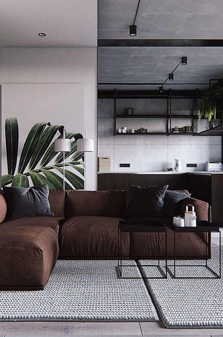 ciemnobrązowa sofa i czarna kuchnia